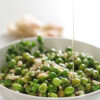 stewed peas with onions and pine nuts