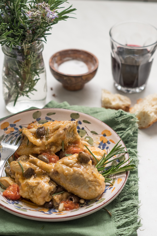 Traditional Italian Riviera braised chicken with tomatoes, olives, pine nuts, garlic and rosemary.